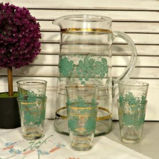 Mid Century Glass water jug and 6 matching glasses.  A pretty mid century glass jug and glasses decorated with grapes and vine leaves. Perfect for serving lemonade