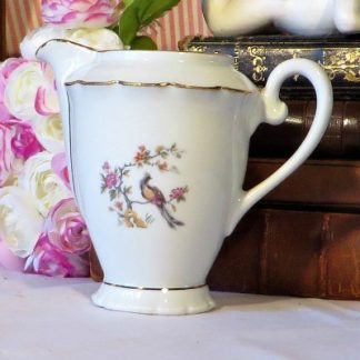 Vintage French Porcelain Milk/Cream Jug. Pretty 1920s/30s Deco porcelain milk/cream jug decorated with flowers an a bird. It has an attractive fluted edge around the top and is edged in gold.