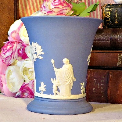 Traditional Wedgewood Blue Jasperware Vase.  A lovely vase in blue Jasperware by Wedgewood.  This iconic neo classical design is so familiar to all of us who love Wedgewood.