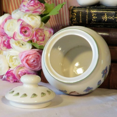 this lovely covered sugar bowl is beautifully decorated with flowers and a butterfly.  A super addition to your afternoon tea table
