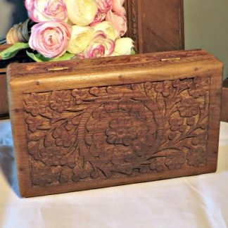Carved Wooden Box. A pretty hinged wooden box carved with flowers and foliage. Could be used for jewellery