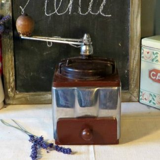 Bakelite and Chrome Vintage French Coffee Grinder. Made by Peugeot Brothers (they made coffee grinders and bikes before they started making cars!)