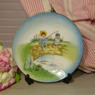 Coalport Cabinet Plate Children Fishing on a Bridge. A charming cabinet plate depicting children in Victorian style clothing fishing off a bridge. This plate would make a lovely Christening gift or add it to your cabinet plate collection