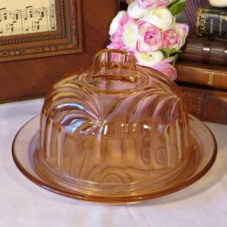 Pink Depression Glass Cheese Dome.  A lovely moulded glass cheese dome decorated with swirls and spirals to make your cheese feel very special!