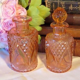 Pink Depression Glass Perfume Bottles.  Two pretty cut glass perfume bottles for your dressing table
