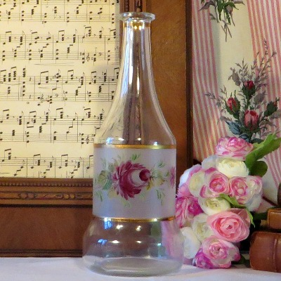 Floral Carafe Decanter Bottle.  A clear glass carafe with a frosted glass band which has been hand painted with a floral design.  The frosted section is outlined with gold.