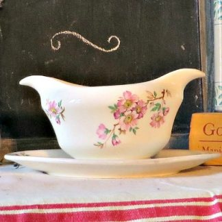 French Floral gravy/sauce boat. Made by Mosa of Maastricht. this double lipped sauce boat is complete with attached saucer