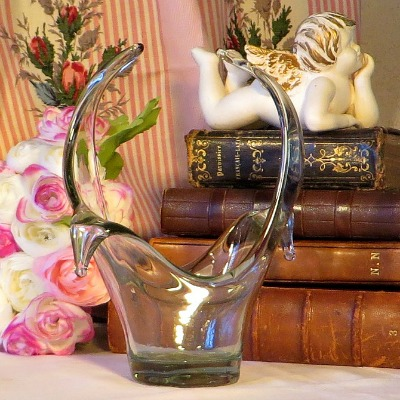 as a vase or just simply for decoration. The glass has a light green colour .