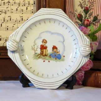 Limoges Children's Chafing Dish Heated Baby Plate. A pretty baby's food warming plate hand painted with two children in Dutch costume playing musical instruments.
