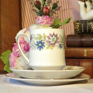 Paragon 'Cherwell' Coffee Trio.  A lovely fine bone china 1960s/70s coffee trio made by Paragon in the 'Cherwell' pattern.  The design features ribbed china decorated in purple and blue flowers and edged in gold.