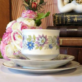 'Cherwell' Tea Trio by Paragon.  A lovely fine bone china 1960s/70s tea trio made by Paragon in the 'Cherwell' pattern.  The design features ribbed china decorated in purple and blue flowers and edged in gold.