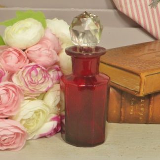 Victorian Ruby Red Glass Perfume/Dressing Table Bottle with Cut Glass Stopper. An elegant dark green glass faceted perfume/dressing table bottle with original clear cut glass stopper.