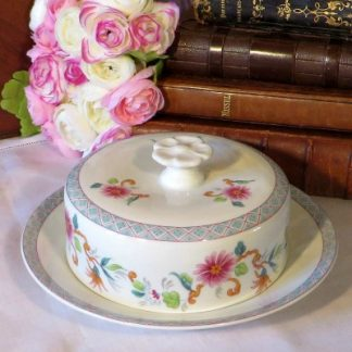 Limoges Butter/Cheese Covered Cheese Dish. Pretty Limoges covered butter/cheese dish beautifully hand painted with flowers and a triangular design and topped off with a charming flower handle. This lovely dish is ideal for you table or for your collection