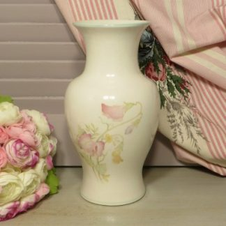 1980s Floral Sadler Vase.  A beautiful cream vase decorated with pink flowers with a green trim around the top. This pretty vase will look beautiful when full of fresh or faux flowers