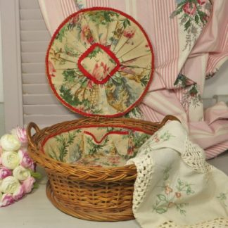 French Wicker Sewing Basket.  A pretty wicker sewing basket with a floral lining and pin cushion.