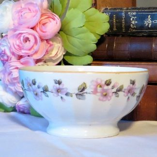 Floral French café au lait/hot chocolate bowl.  Edged with a mustard yellow and decorated with pretty pink flowers