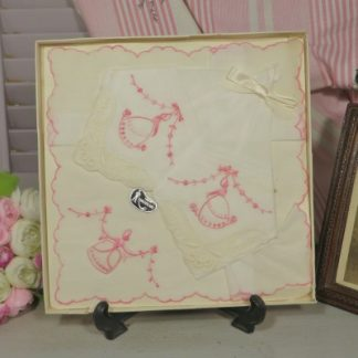 Box Set of Fine Linen/Lawn Swiss Handkerchiefs.  Three beautiful Ladies handkerchiefs with pink embroidered Crinoline Ladies and Cream lace edging.  A 1970's or 60's souvenir from Switzerland