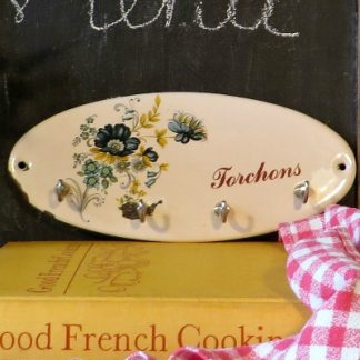 Floral French Mid Century Enamel Torchon Rack.  A Torchon is a French tea towel and this pretty floral enamel rack is perfect for hanging in a vintage kitchen to keep your kitchen towels tidy