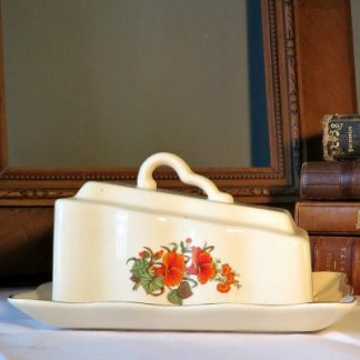 Traditional Wedge Cheese Dish.  Cream cheese dish with orange flower decoration and edge with gold gilding