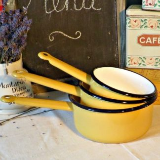 Set of 3 Mustard Yellow Vintage French Enamel Saucepans  A lovely set of 3 vintage French enamel saucepans in a lovely mustard yellow with a black rim and white interior.  Each pan has a hole in the handle for hanging and would make a wonderful addition to your vintage kitchen to either use or for decoration